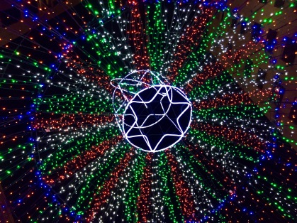 Giant Christmas ornament sculpture lights from below.