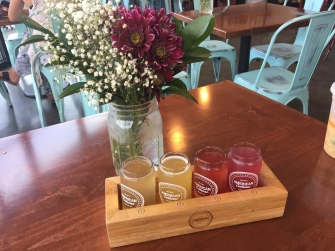 kombucha flight with flowers